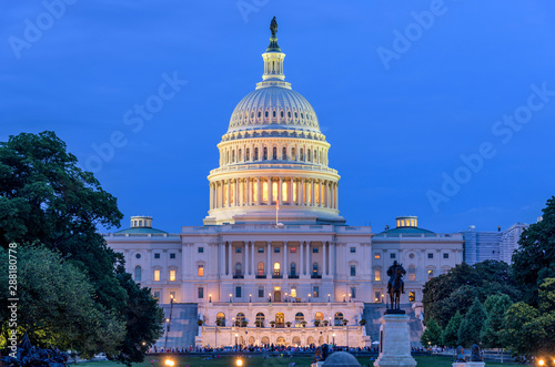 Obraz Summer Night at Capitol - A dusk view of west-side of U.S. Capitol Building, as a small crowd gathering around a summer concert at front, Washington, D.C., USA. No recognizable trademark or person.  - fototapety do salonu