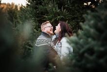 Couple Posing For Christmas Card Photos
