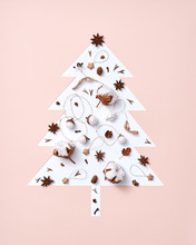 Christmas Composition Of Dry Leaves, Pine Cones, Anise And Paper Stars In The Shape Of A Christmas Tree On A Beige-gray Background With Copy Space. Postcard. Flat Lay