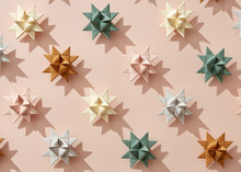 Origami Stars Made Of Paper On Beige Background With Shadows. Creative New Year Pattern. Flat Lay