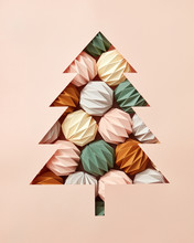 Handcraft Composition Of Origami Colored Balls And A Christmas Tree Cut Out Of Beige Cardboard With Copy Space. Flat Lay