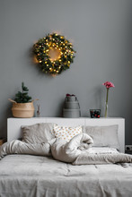 Christmas Wreath Over Unmade Bed