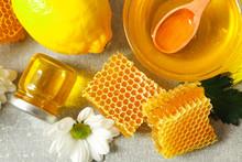 Honey, Flowers And Lemon On Gr...