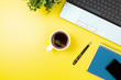 canvas print picture - Laptop, notebook, smartphone, coffee and pen on yellow background.  Office desk table with modern accessories