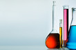 Leinwandbild Motiv Different laboratory glassware with color liquid and with reflection