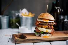 Mouth-watering Burger On Wooden Board