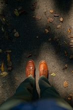 Men's Boots On Trail In Autumn.