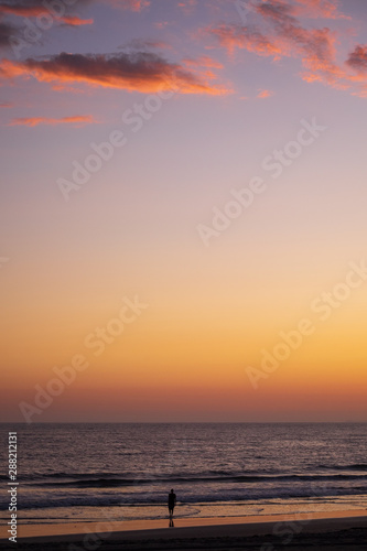 Sunset view of sky and sea at the Santa Monica State Beach in California.