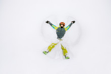 Teenage Skier Making A Snow Angel, Viewed From Above