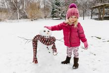 Child Building Snowman