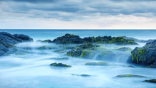 Long Exposure Of Mystery Ocean And Rocks. Tropical Landscape With Surreal Stones On Sea Beach. Scenic View Of Water Like Fog And Mist. Beautiful Panorama Of Magic Nature In Evening.