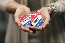 Election: Woman Holding Handfu...