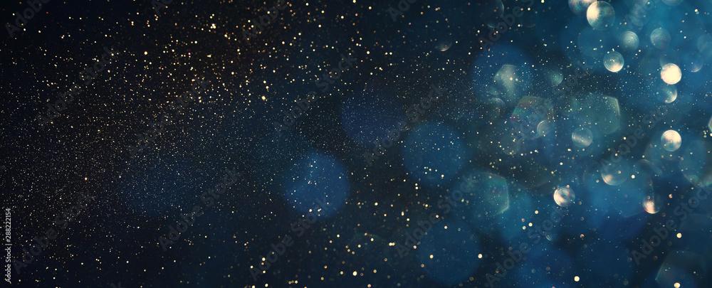 Fototapeta background of abstract glitter lights. blue, gold and black. de focused. banner
