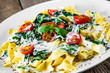Leinwanddruck Bild Tagliatelle with spinach, cherry tomatoes and sauce
