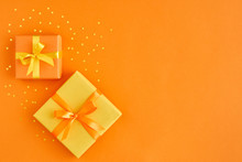 Two Gift Boxes With Ribbon And...