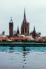 Blurred Old Amazing Church With Pool Of Crystal Calm Water Reflecting Blue Sky In Barcelona Spain