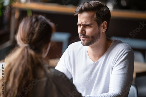 Doubting dissatisfied man looking at woman, bad first date concept Wallpaper Mural