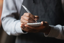 Close Up African American Waiter Hands With Notebook, Taking Customer Order