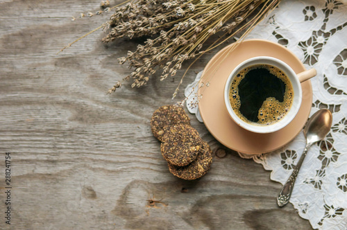 Cafe cup of coffee and cookies on wooden table. Autumn coffee concept