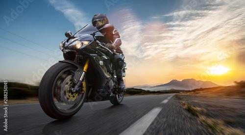motorbike on the road riding Fotobehang