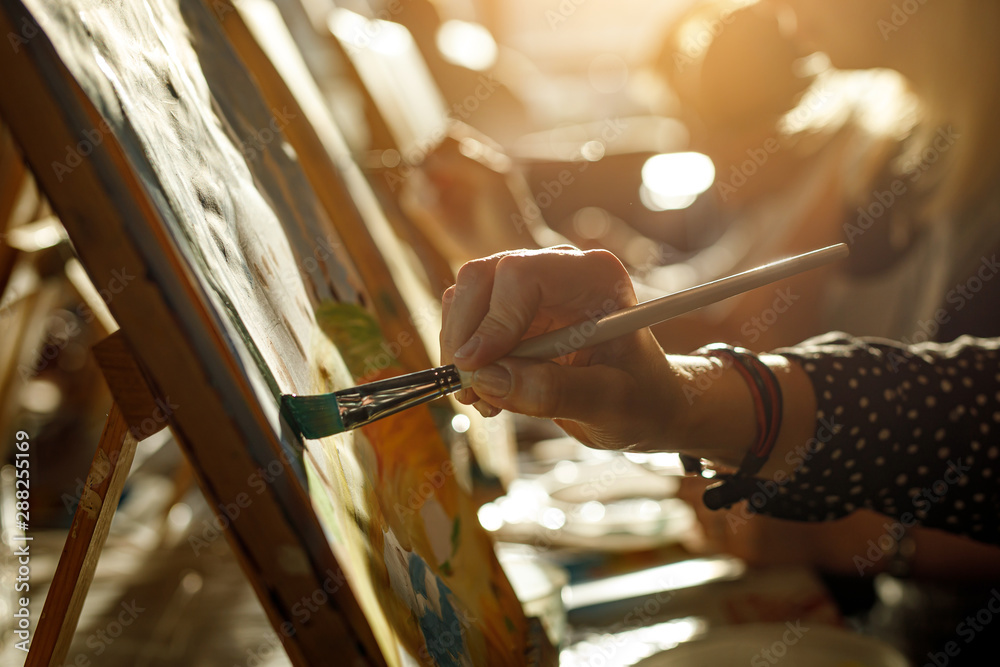 Fototapety, obrazy: hand of artist with brush painting picture
