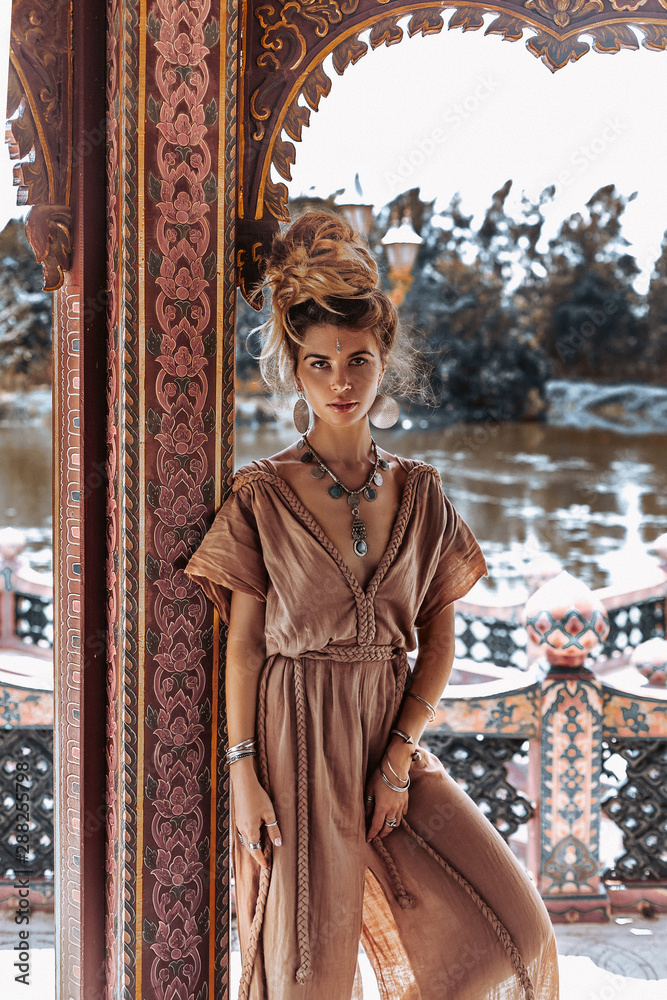 Fototapety, obrazy: beautiful young boho woman in elegant dress at the ancient temple background