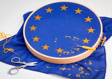 European Flag Symbol Of The European Union And The Council Of Europe With UK Star Being Unpicked And Removed, UK Leaving The European Union Concept.
