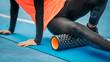 Leinwanddruck Bild - Female Athlete using Foam Roller