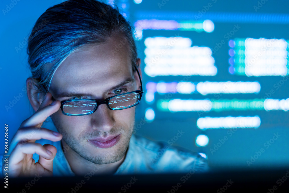 Fototapety, obrazy: Software developer freelancer with code reflection in glass work with program code C++ Java Javascript at night Develops new web desktop mobile application or framework Projector futuristic background