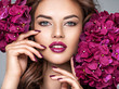 canvas print picture -  woman with purple make-up of lips and fingernails