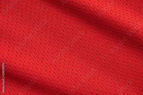 fototapeta na drzwi i meble Red sports clothing fabric football jersey texture close up