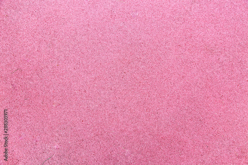 Background of rubberized coating used in children's and sports grounds pink. Backgrounds texture design.