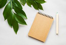 Craft Notebook And Green Leaves