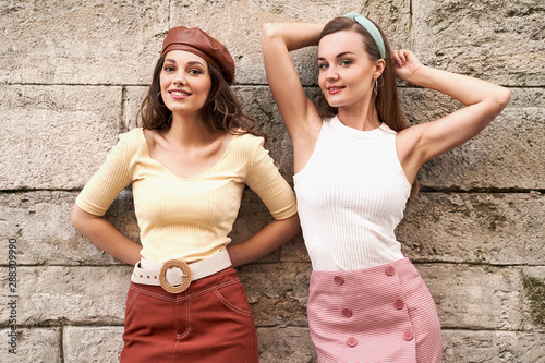 Papel de parede Young beautiful girls dressed in retro vintage style enjoying the old european c