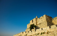 Israeli Jerusalem Ancient City Entrance Gate Fortification Stone Building Famous World Heritage Site Foreshortening From Below On Blue Sky Background With Empty Space For Copy Or Text