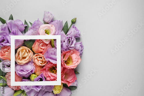 Fototapety, obrazy: Flat lay composition with beautiful Eustoma flowers on grey background, space for text