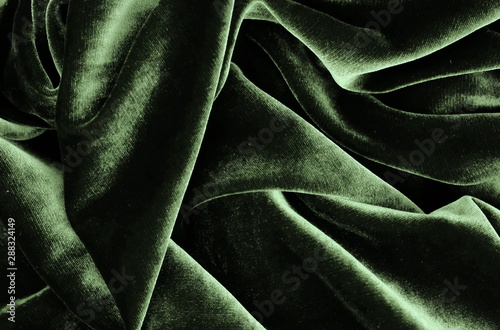 velvet texture grey green colors background, expensive luxury fabric, material, wallpaper. copy space