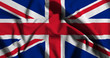 National flag of UK on a waving cotton texture background