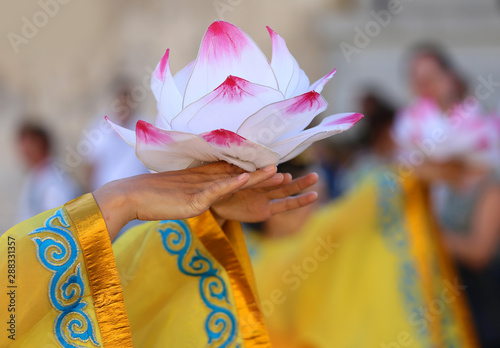 Foto auf Leinwand Lotosblume Lotus Flower on the hands of girl during a dance
