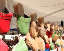 Wooden And Leather Clogs For Sale In The Street Market Stall