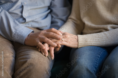 Foto auf Gartenposter Individuell Close up middle aged family couple holding hands, supporting.