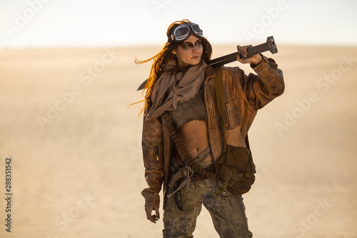 Fotografie, Tablou  Post-apocalyptic Woman Outdoors in a Wasteland