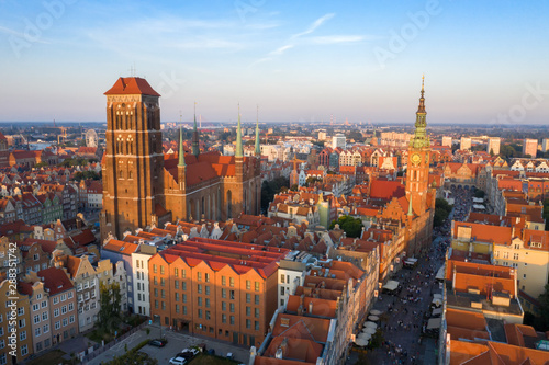 Gdansk is a city in Poland. Gdansk in the morning rays, the sun is reflected from the roofs of the old city. - 288351742