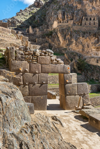 Ollantaytambo ruins with arch through a stone wall