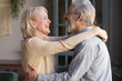 canvas print picture - Happy senior couple relax dancing at home together
