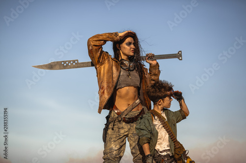 Leinwand Poster Post-apocalyptic Woman and Boy Outdoors in a Wasteland