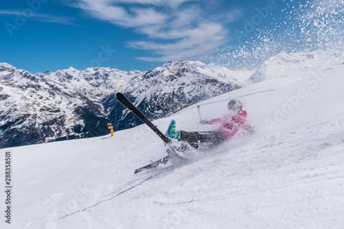 Fotografía Woman skier accident crash on a ski slope with ski flying, Solden, Austria