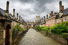 Vicars' Close Oldest Cobblestone Street With Original 14th Century Houses Leading To Vicars' Hall Gateway And Wells Cathedral In Wells England