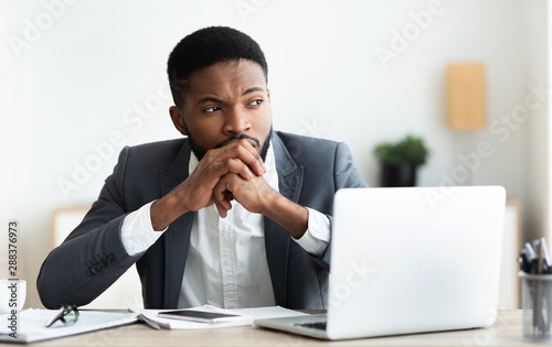 Thoughtful african entrepreneur getting nervous on workplace Canvas Print