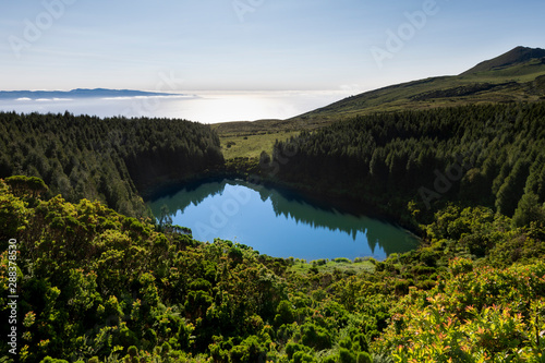 Acrylic Prints Gray traffic Volcanic crater with lake Lagoa Seca on Pico island short after sunrise.